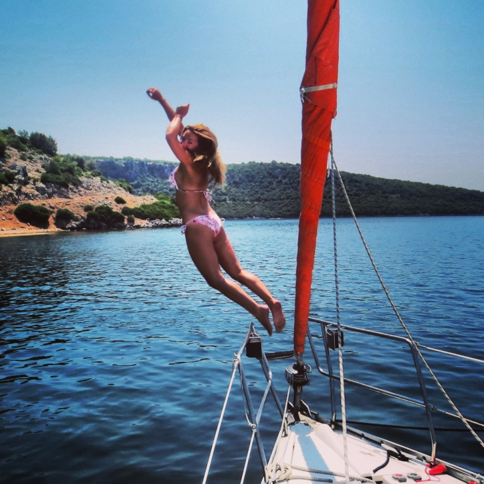 Jumping for joy! On my most recent trip, a sailing trip around the Greek Islands.