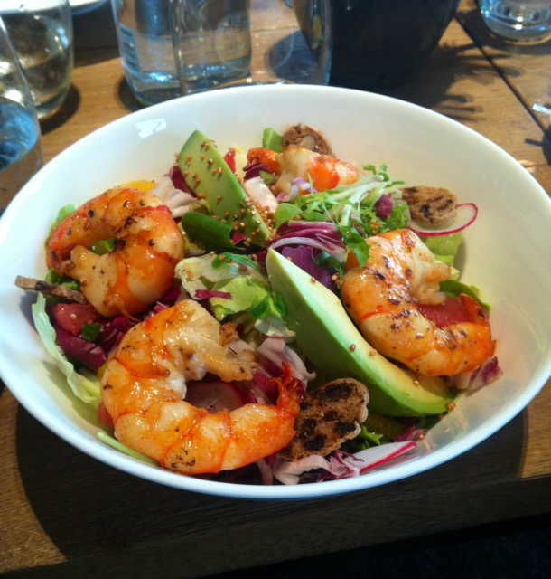 Crunchy salad leaves with avocado, grapefruit, orange slices, king prawns, bell pepper vinaigrette and quinoa